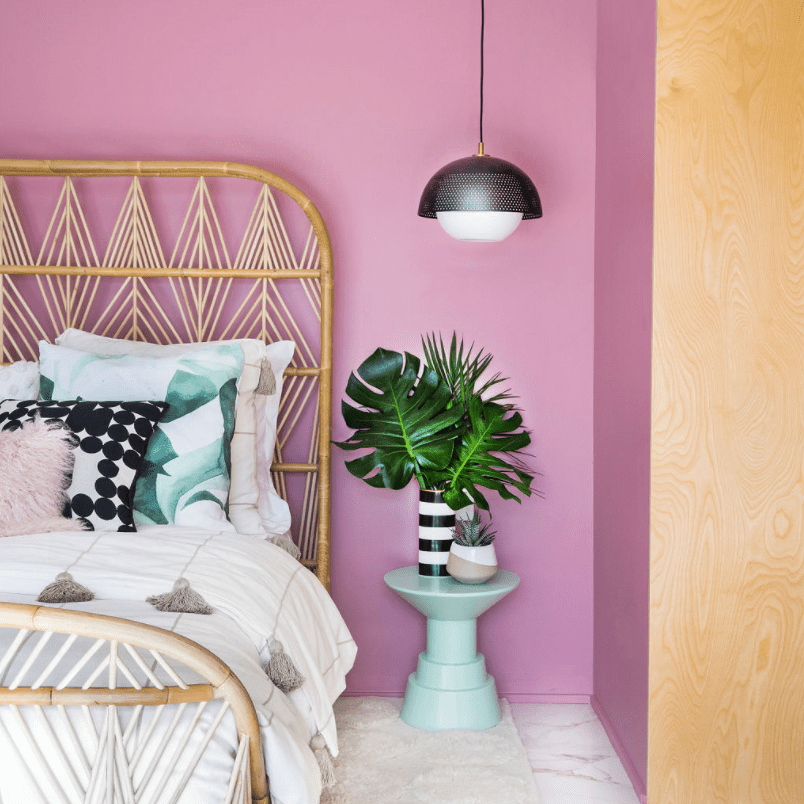A vibrant pink bedroom that feels both bohemian and modern