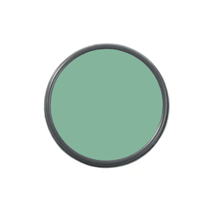 An overhead shot of a paint can with green paint in it