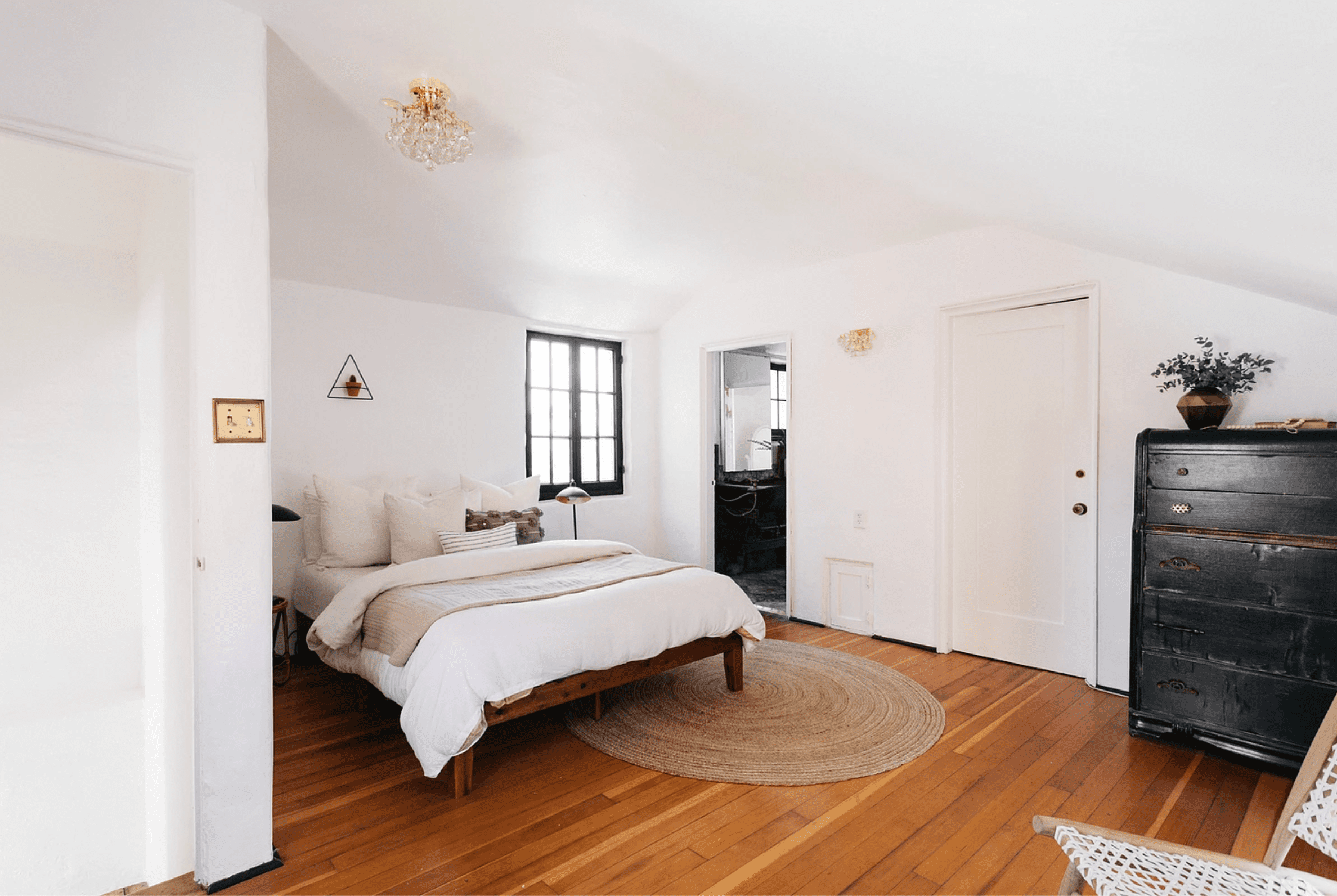 A bedroom with antique furniture
