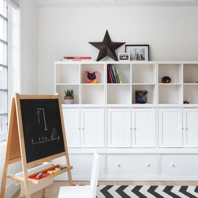 Play room with a coffered ceiling