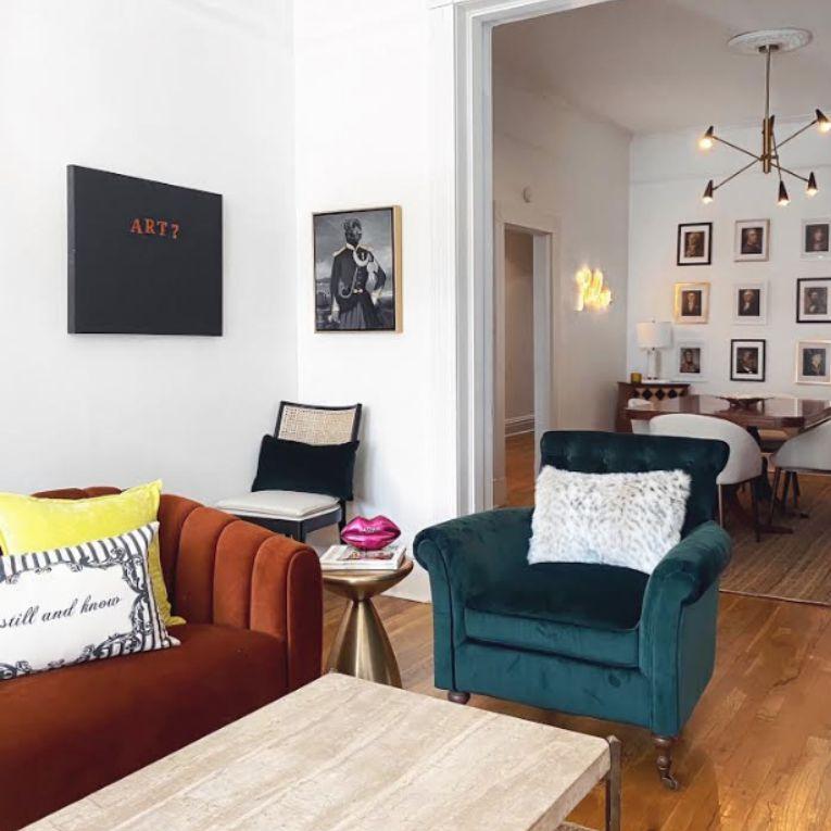 Velvet teal armchair in living room.
