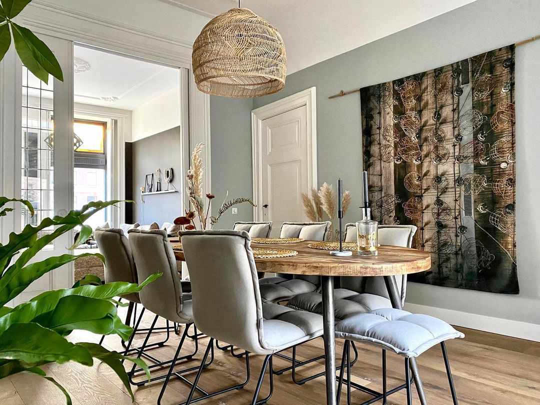 Dining room with a hanging tapestry