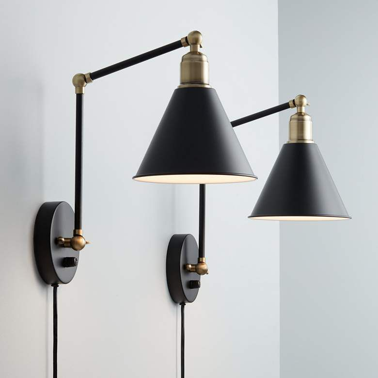 black and gold plug in sconce