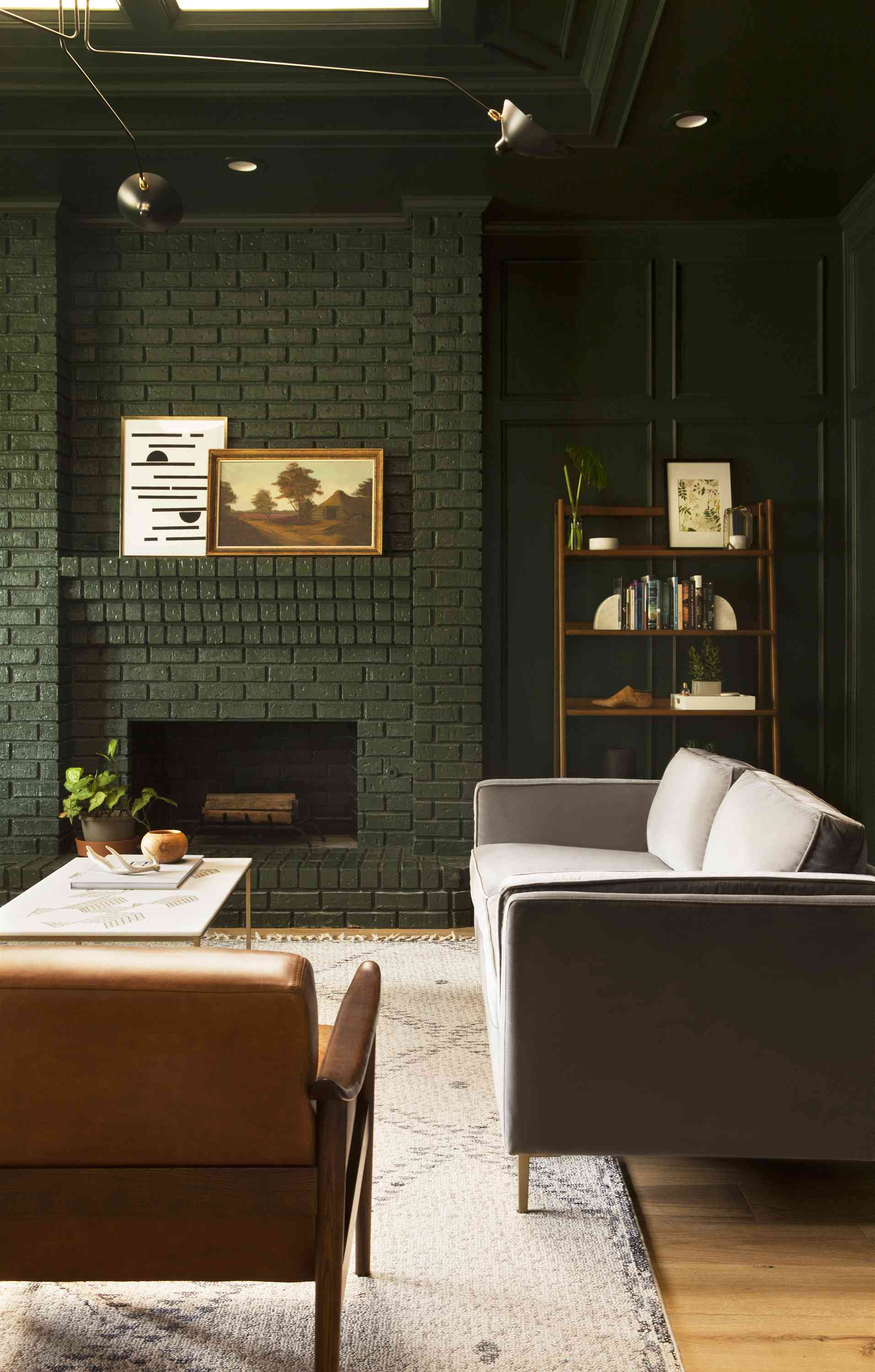 Mid-Century style living room with dark green painting brick and panelling