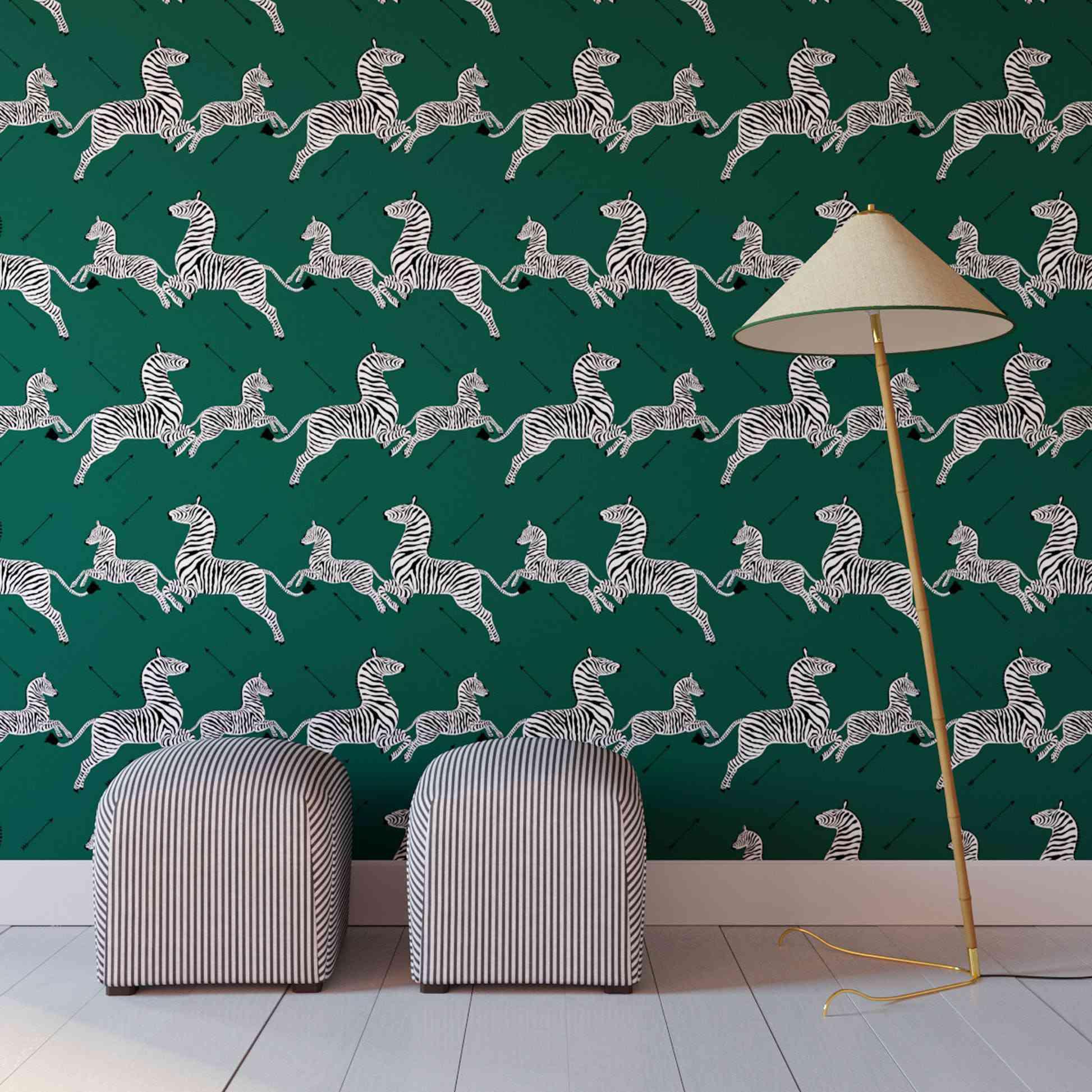 Green wallpaper covered in zebras