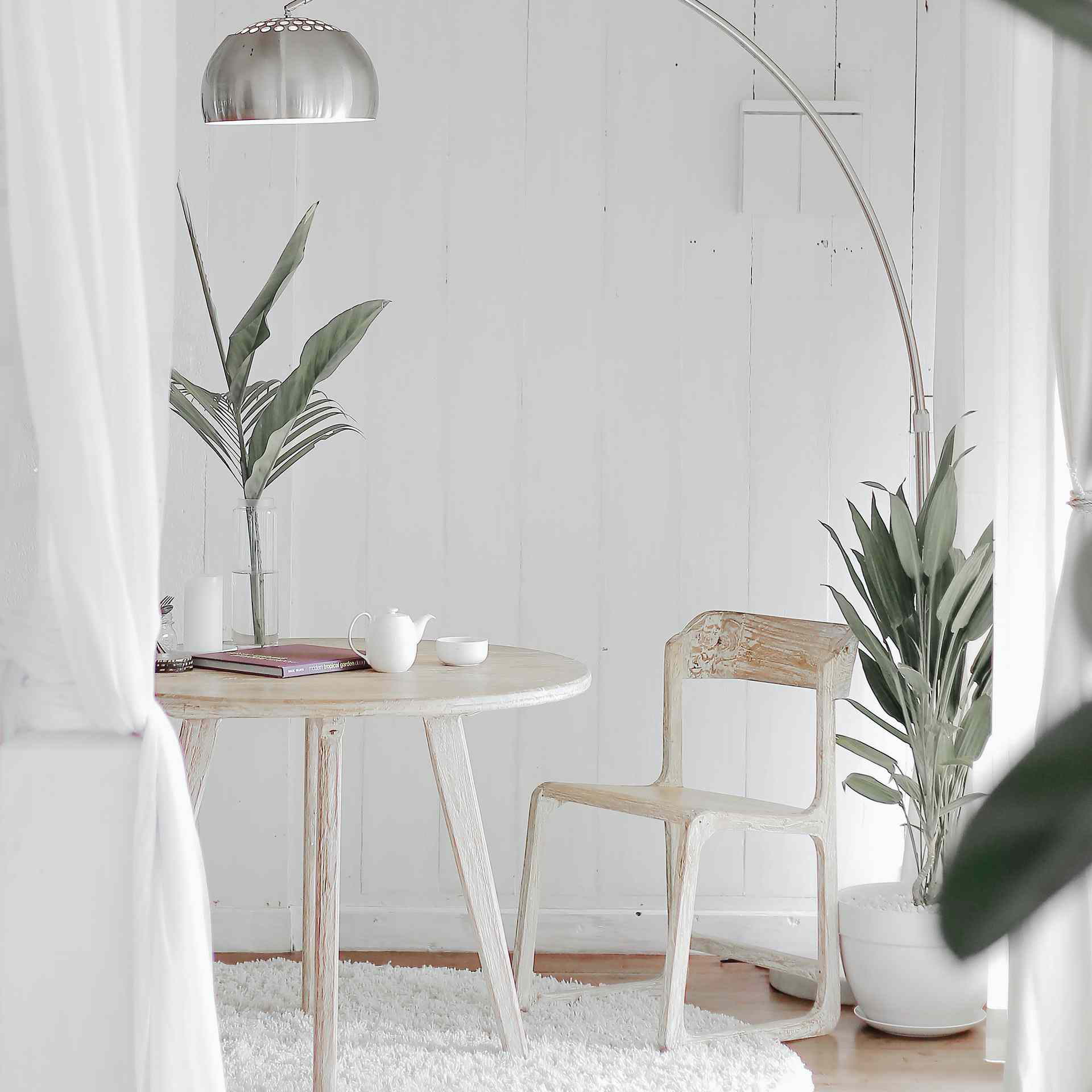 minimalist dining table with silver arch floor lamp