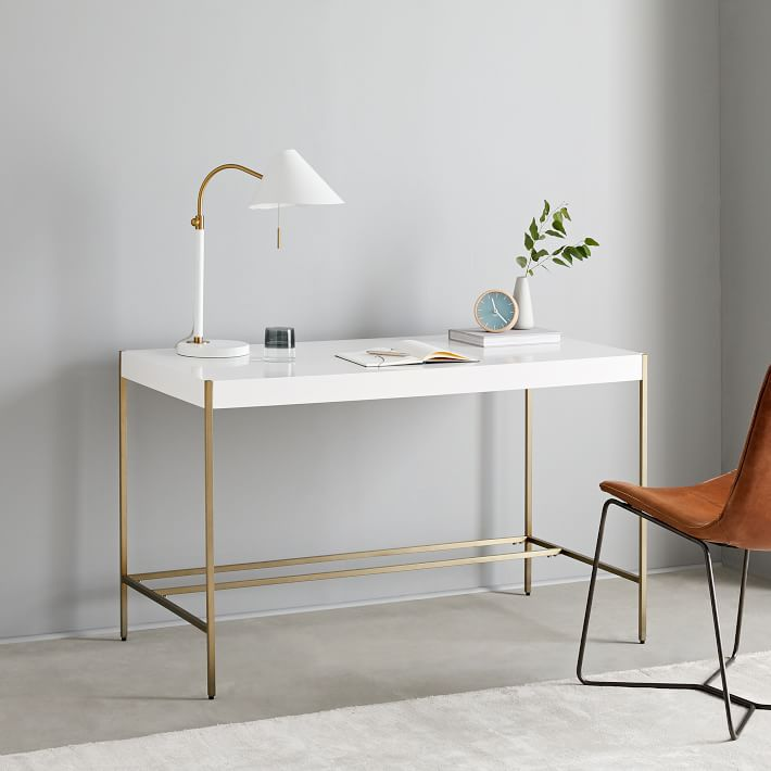 White desk with simple gold legs.