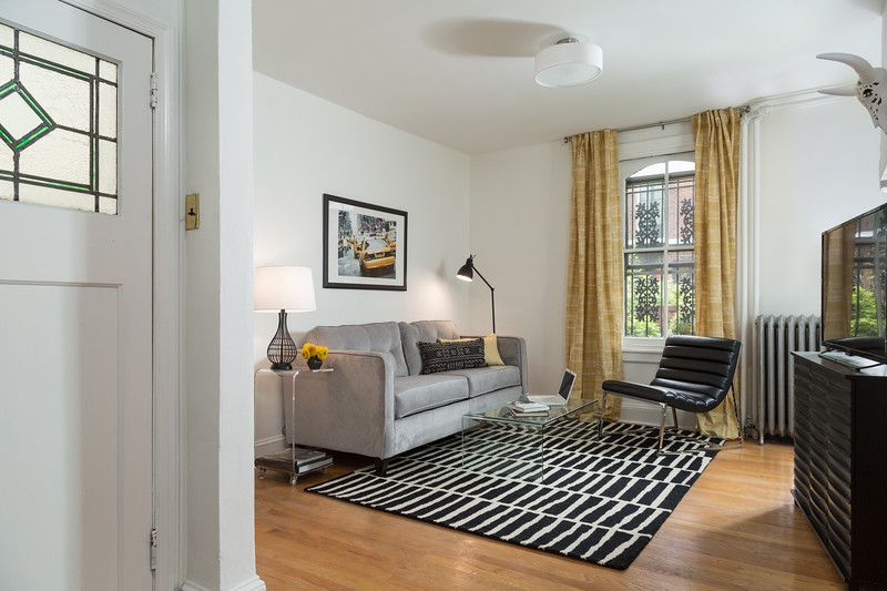 Living room with floor to ceiling drapes