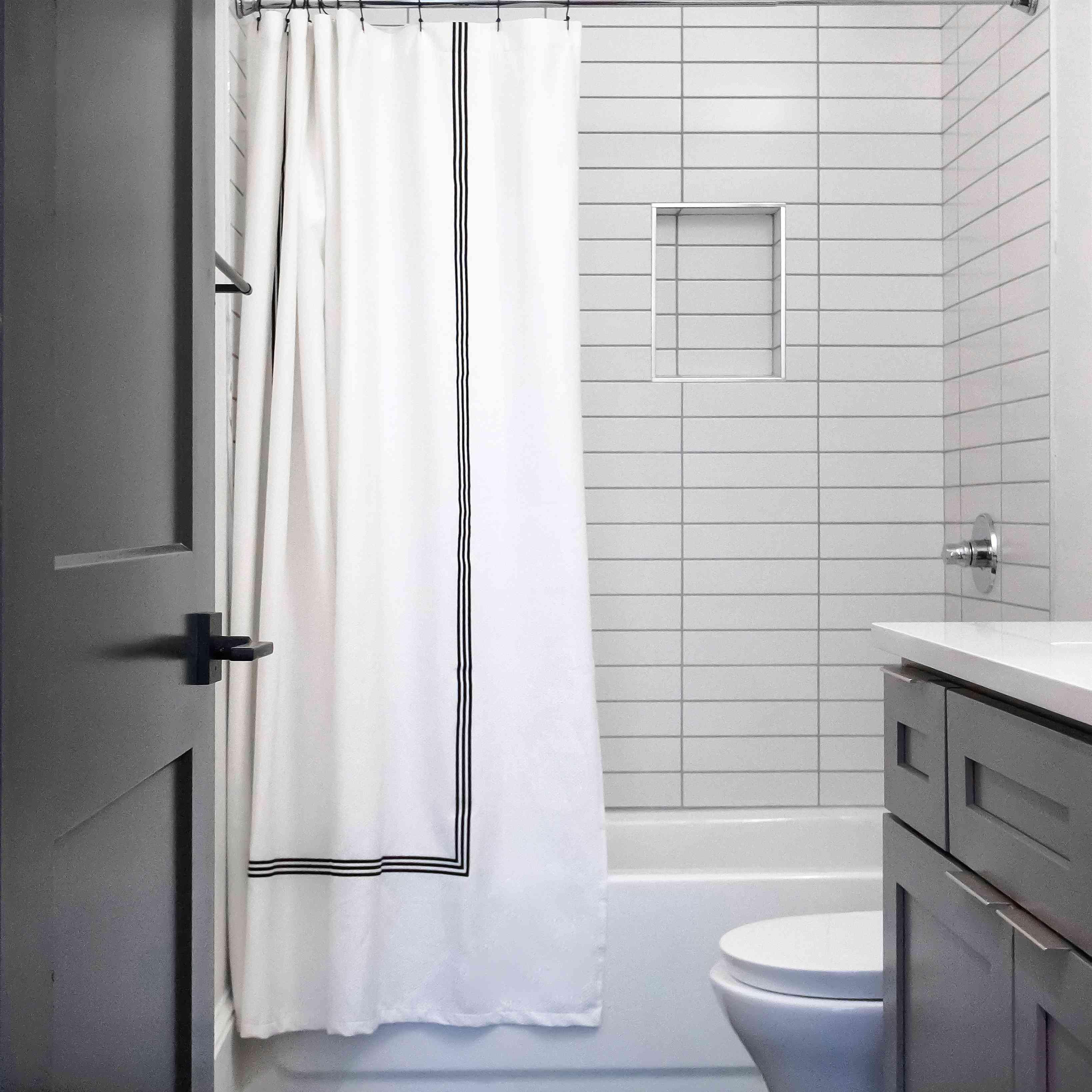 Black tiled bachelor bathroom