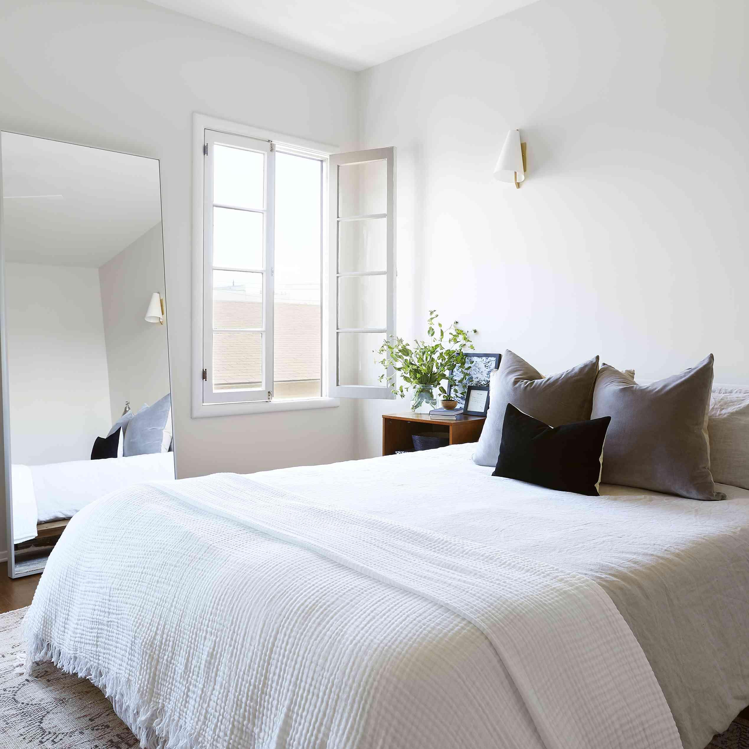 modern bedroom with oversize rectangular mirror