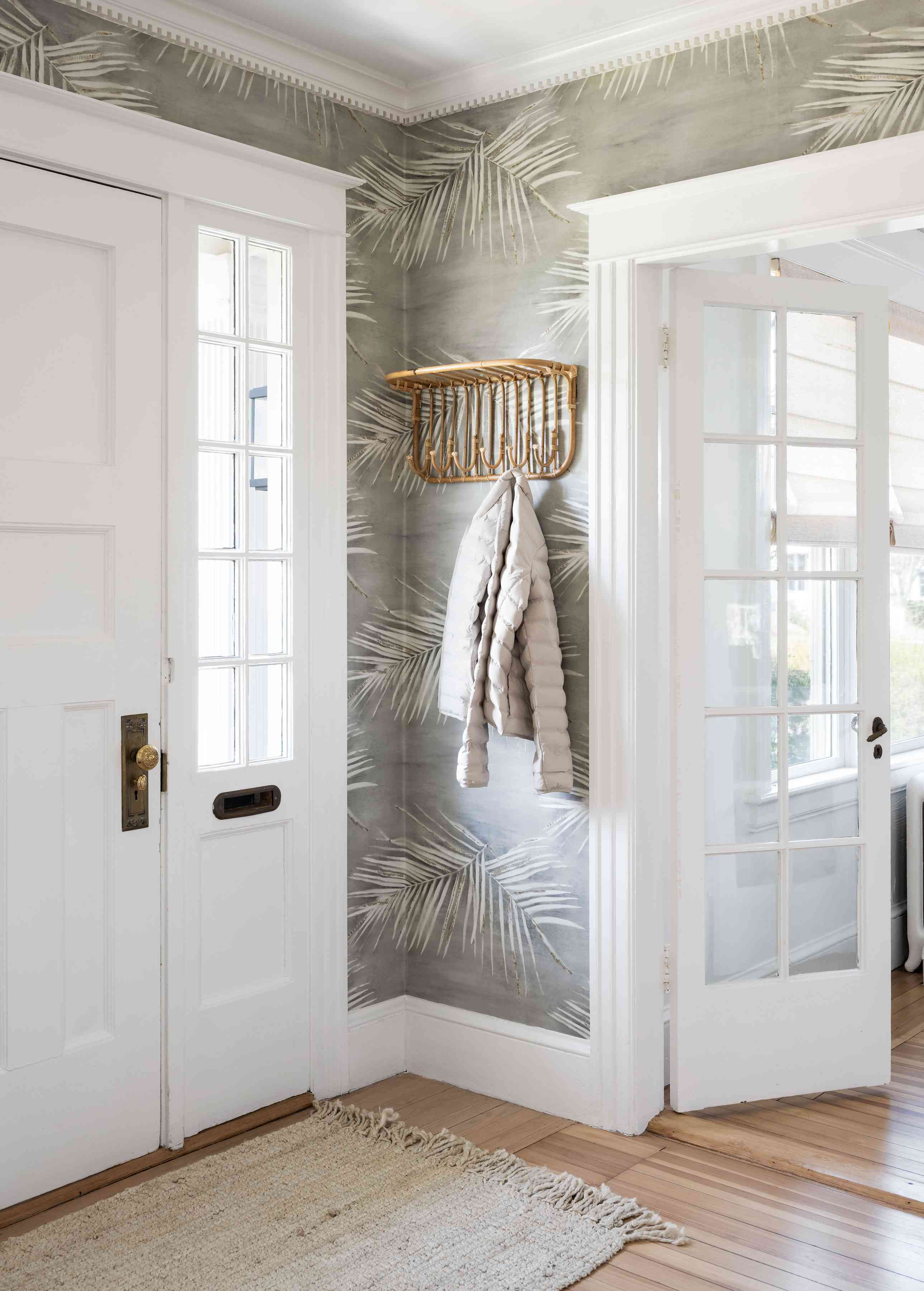 newport beach house entryway with gray frond wallpaper and white trim