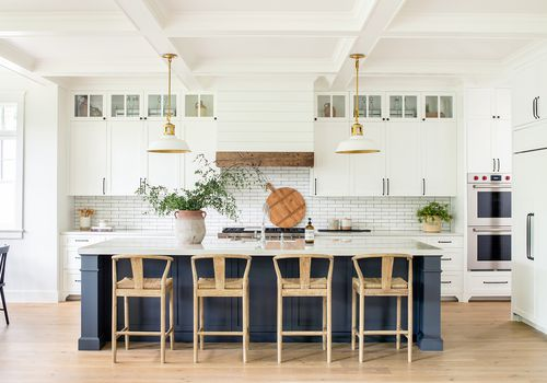White kitchen with blue island.