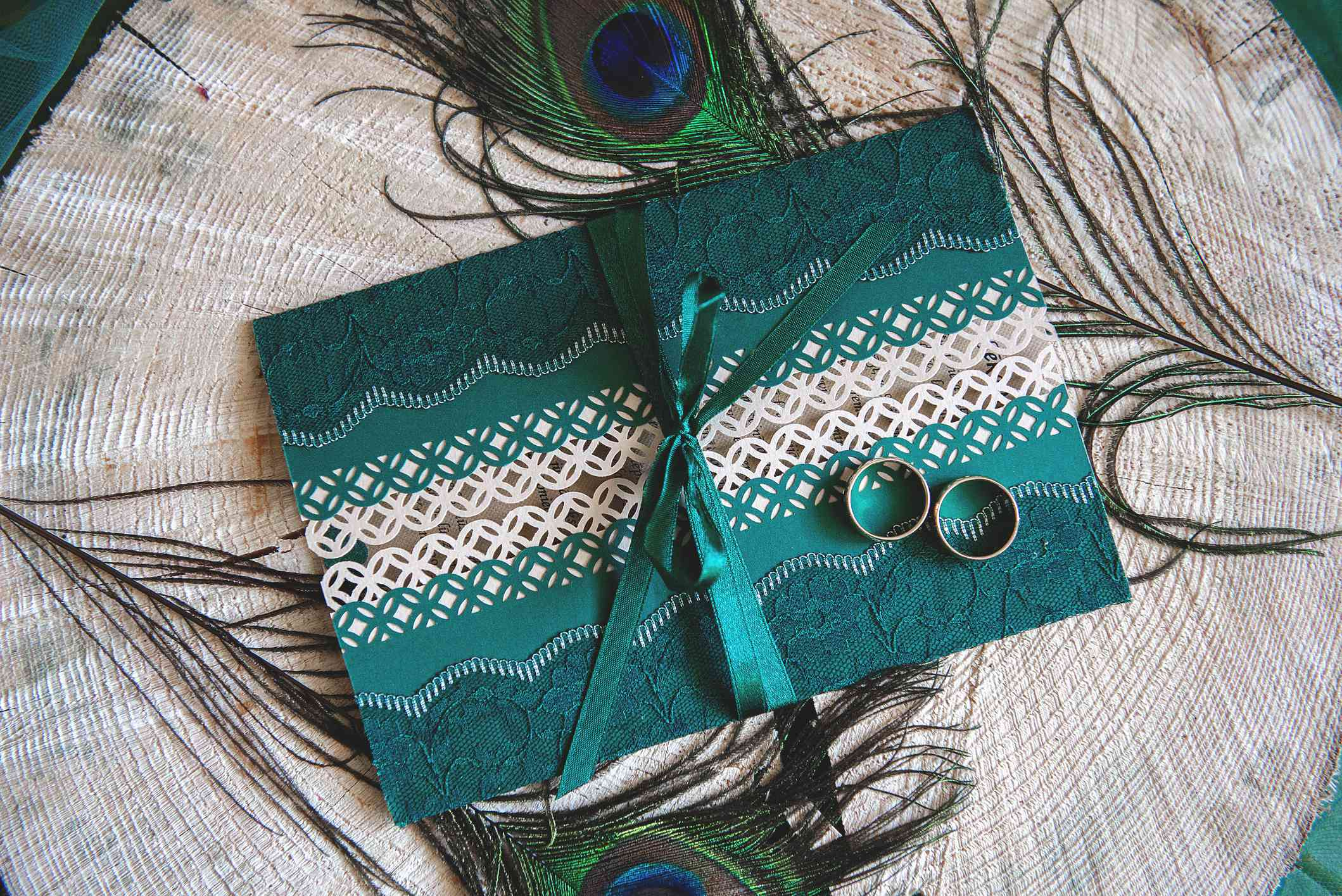 Peacock-themed wedding invitation