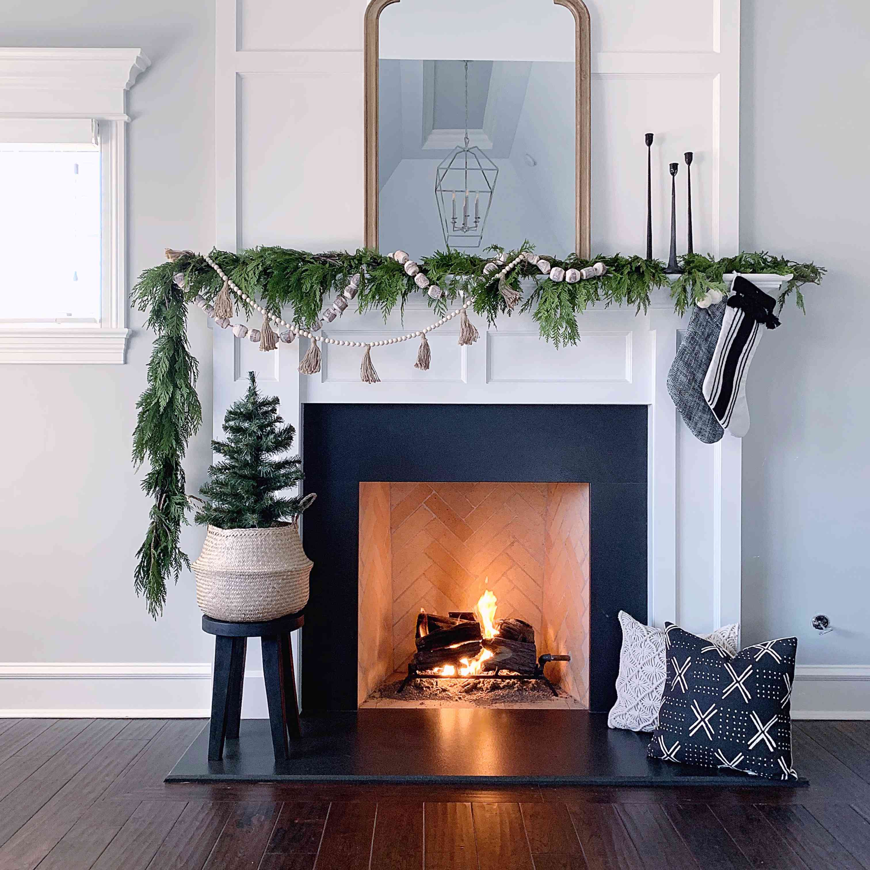 Christmas mantle with lit fire.