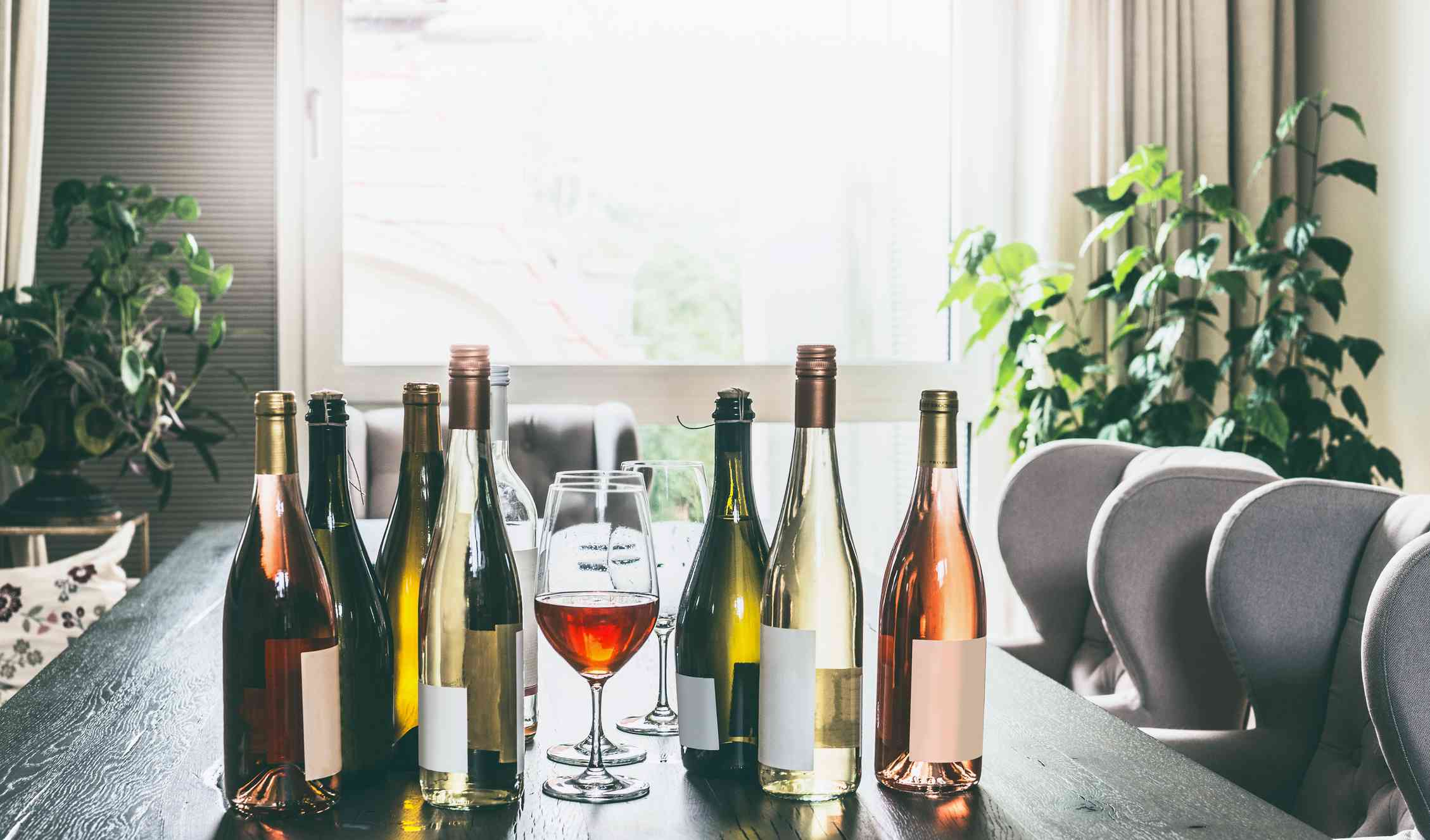 A selection of wine bottles on a dining room table