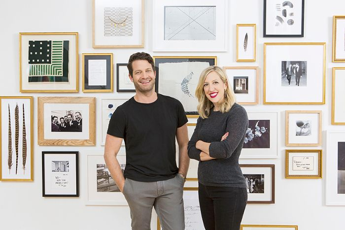 Nate Berkus and a woman in front of a wall of art