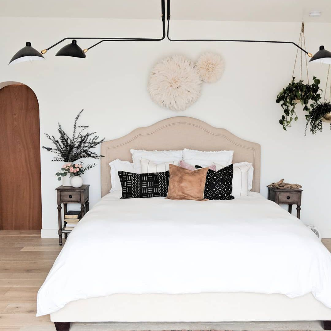 Bedroom that is a mix of boho, traditional and midcentury styles.