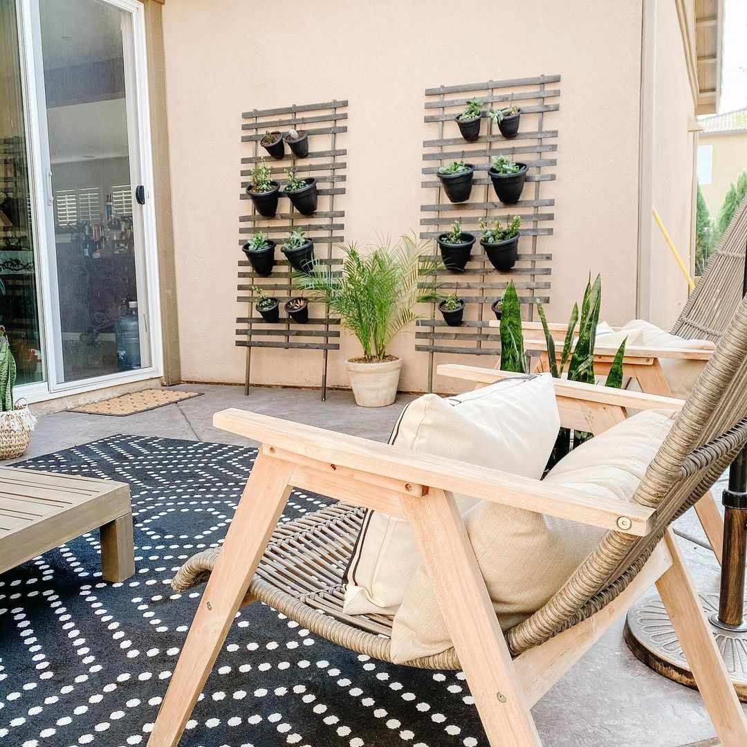 Patio with hanging plants on the wall