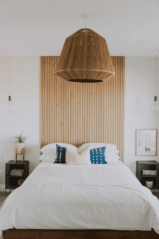 Bedroom with a wood wall behind the bed