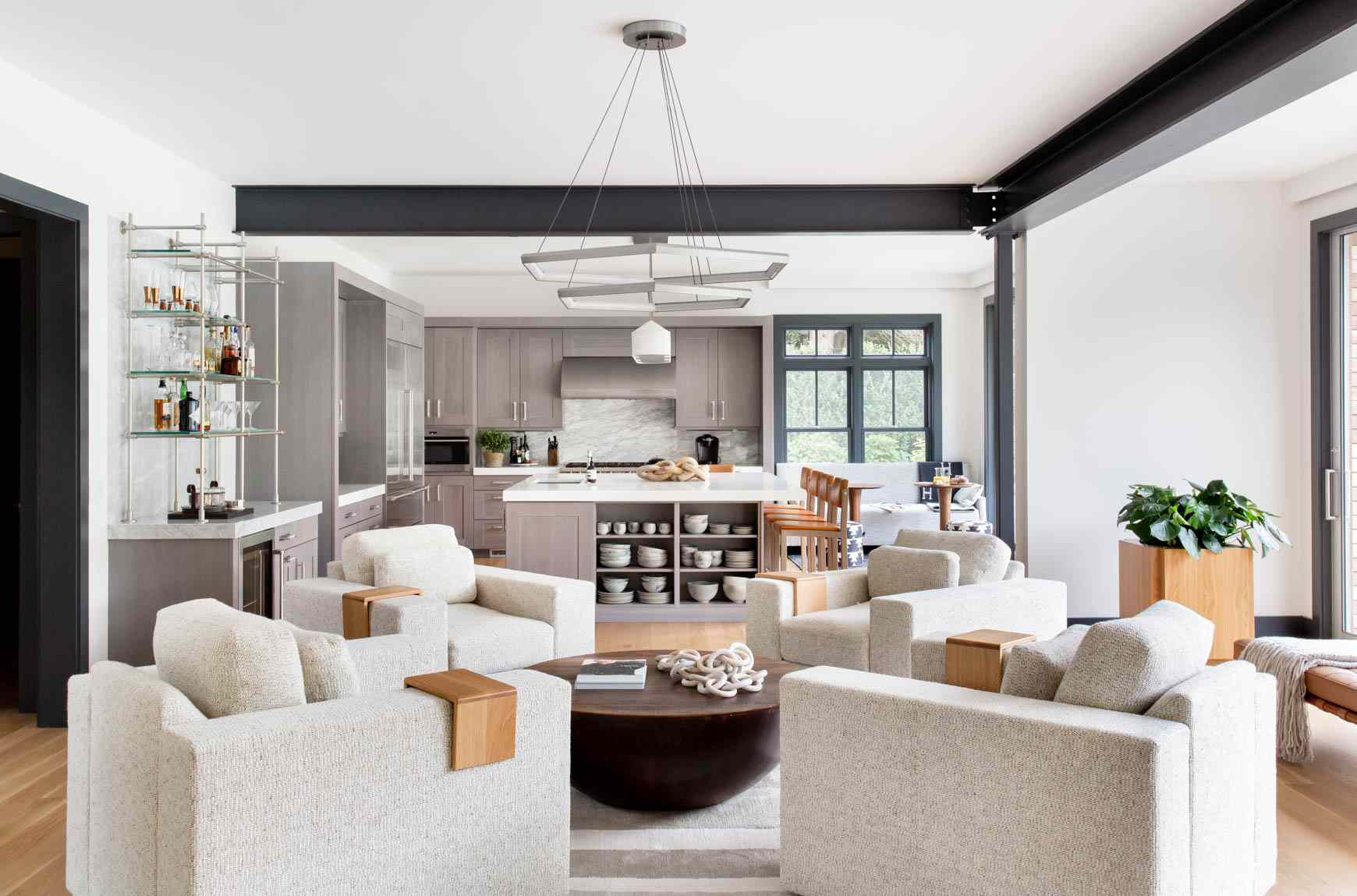 Neutral living room with white chairs.