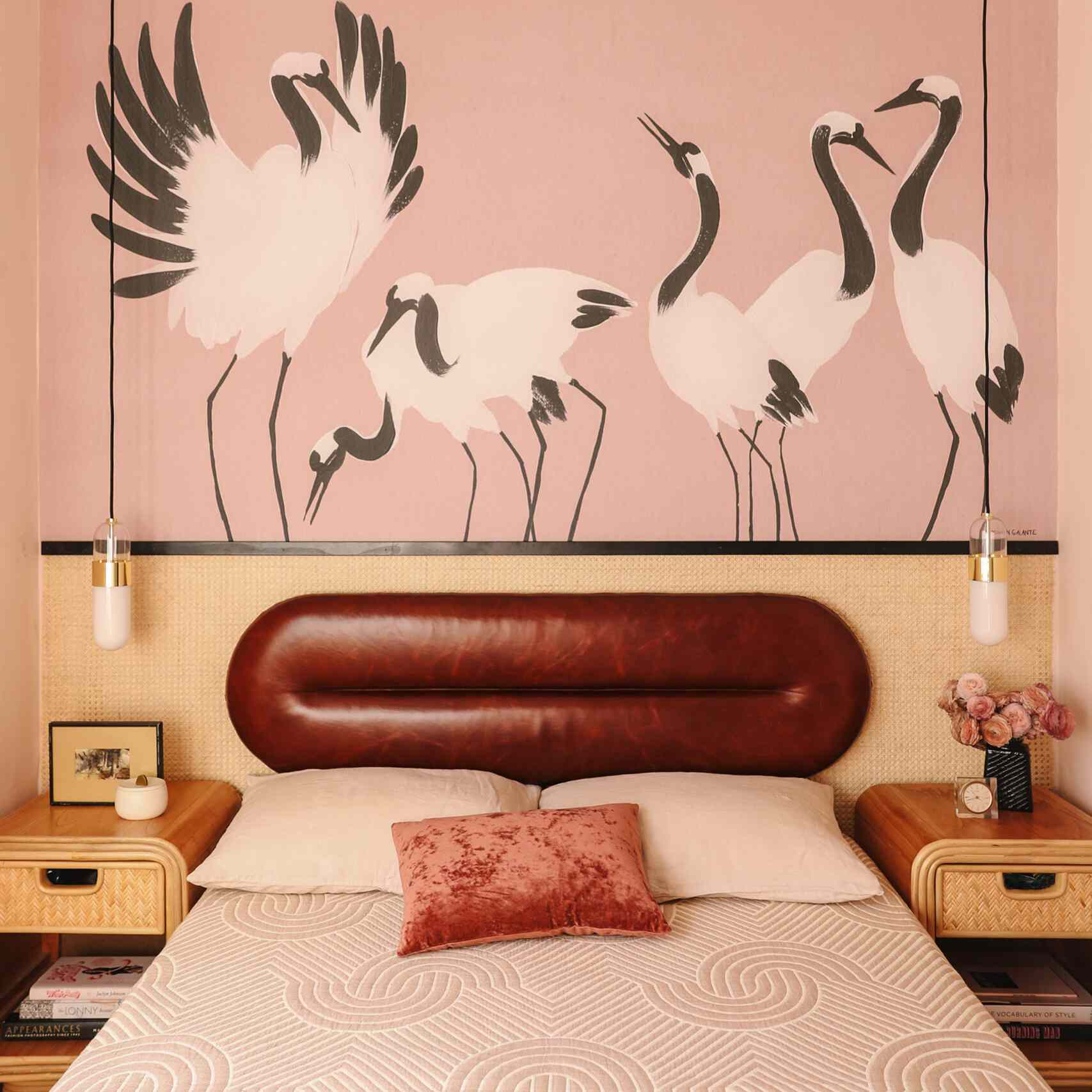 bedtoom with crane mural and leather oval headboard