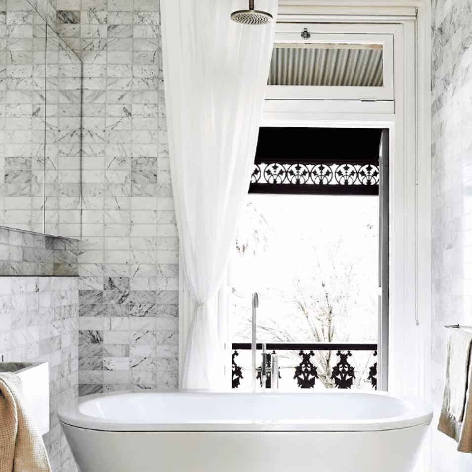 Floor-to-ceiling marble-tiled bathroom