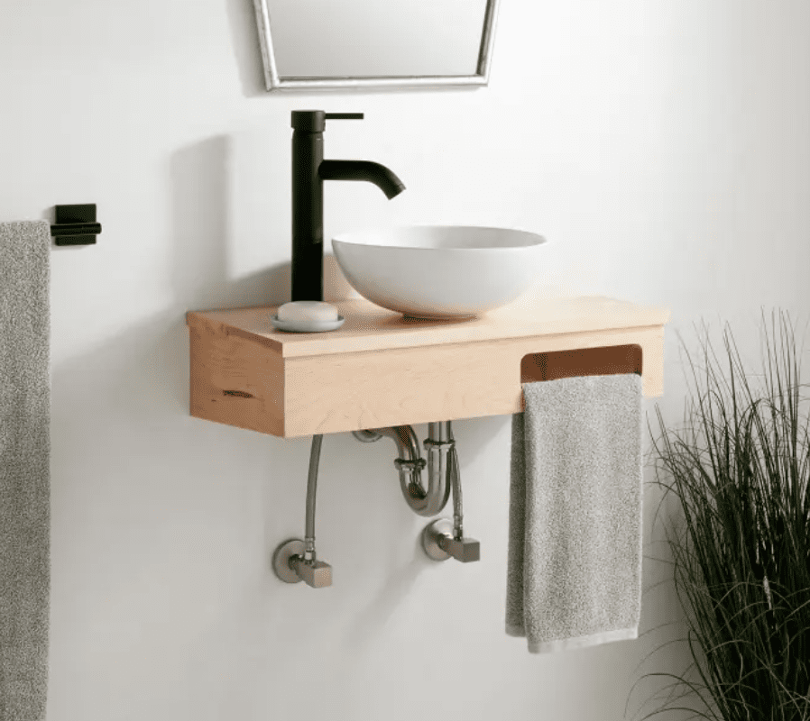 A wall-mounted wooden sink