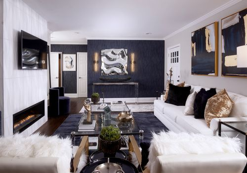 makeover of the week - interior design by s&s, glam living room after with fireplace and navy wallpaper