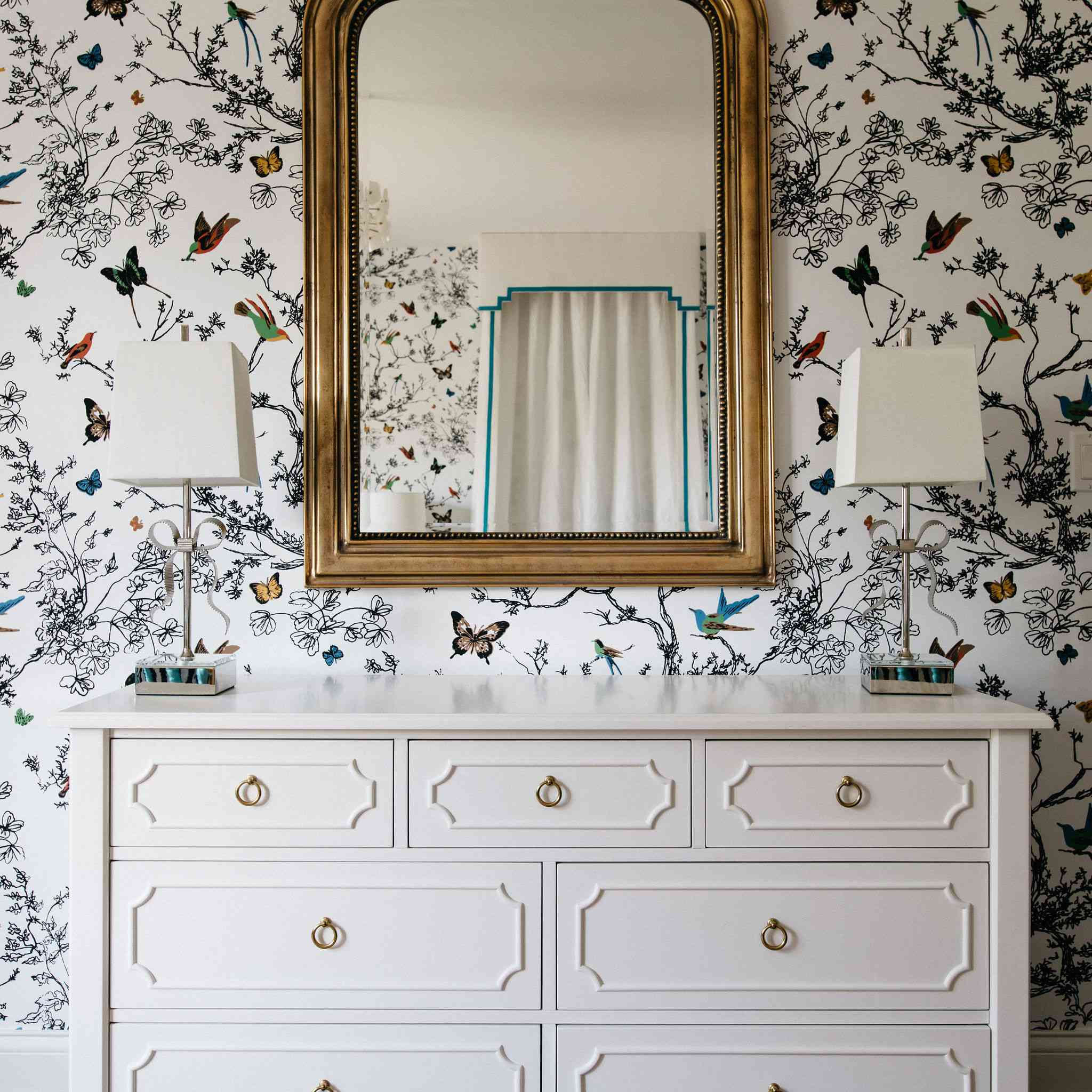makeover of the week - white dresser with antique gold mirror above