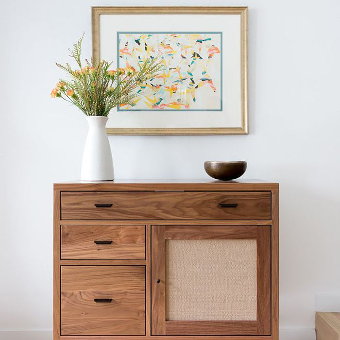 wooden credenza against a white wall