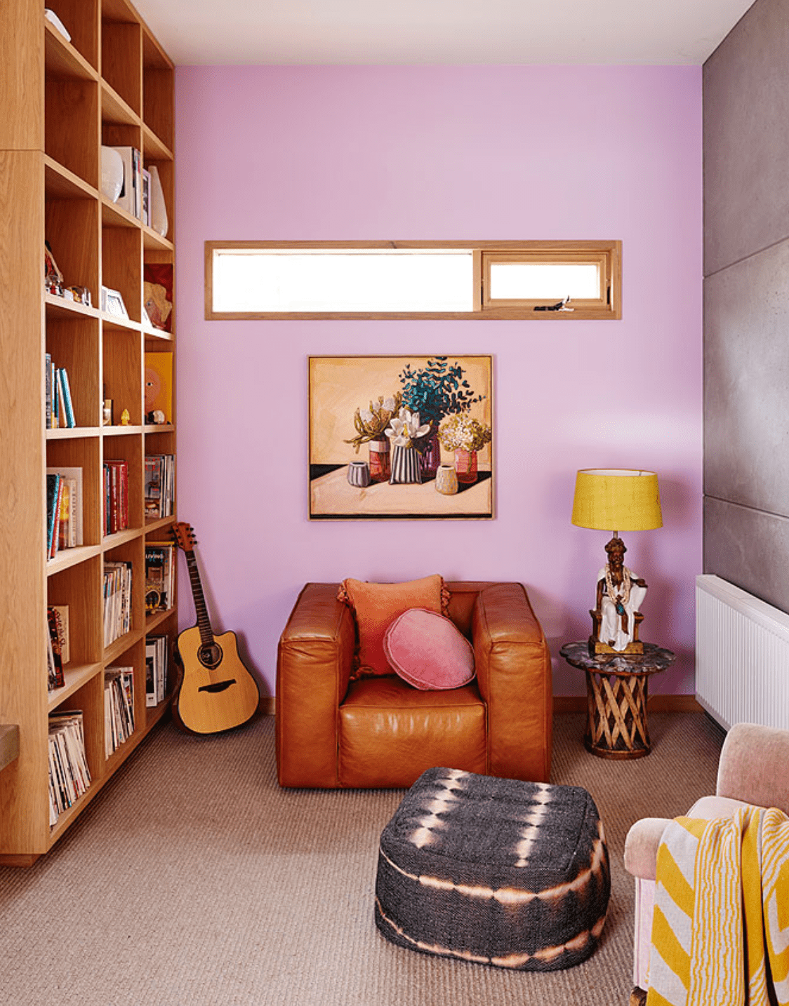 Bohemian-inspired living room with pink accent wall