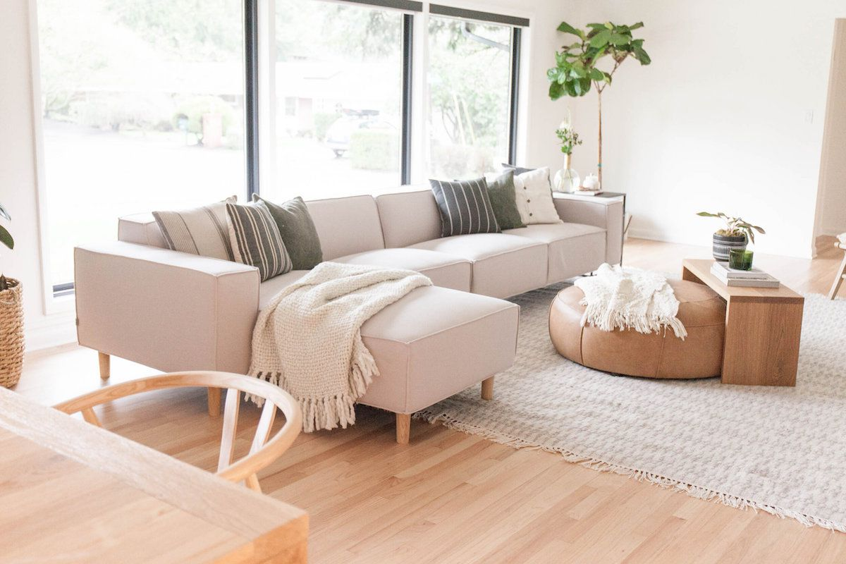 living room with leather pouf