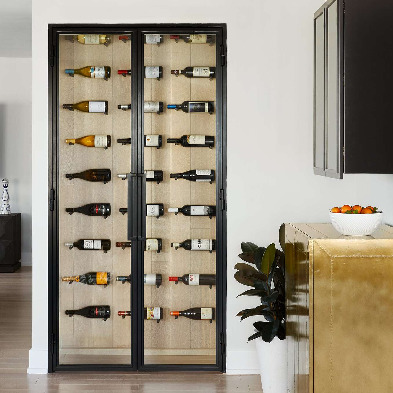 A small kitchen with a built-in wine cellar