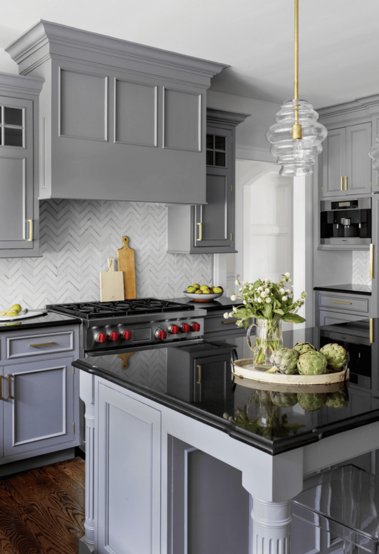 Gray kitchen with cut flowers.