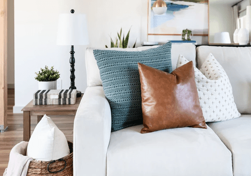 Neutral living room with throw pillows on sofa.