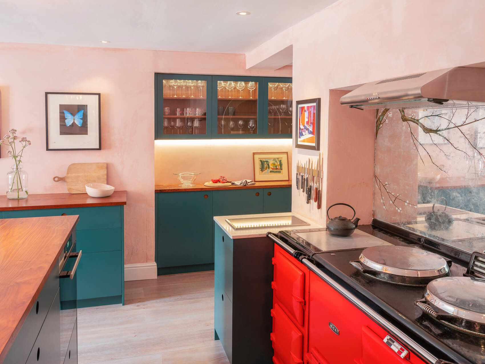 Pink, red, and teal kitchen