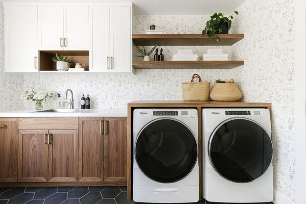 Laundry Room with Black Tile Floors