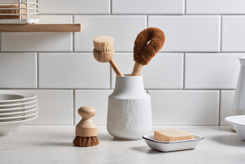 Soap And Brush Near Vase With Cleaning Tools