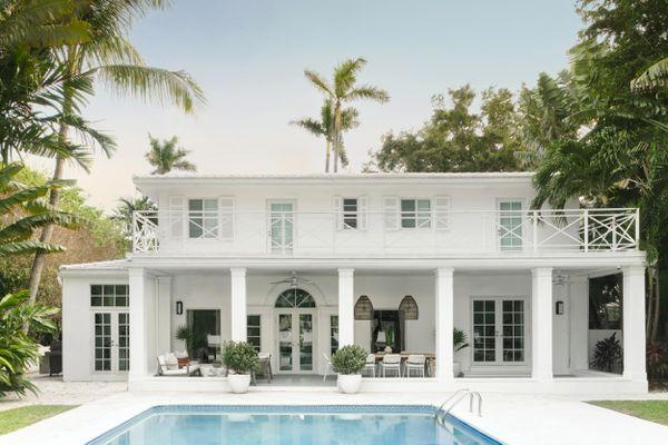 Backyard of grand Miami home with pool.