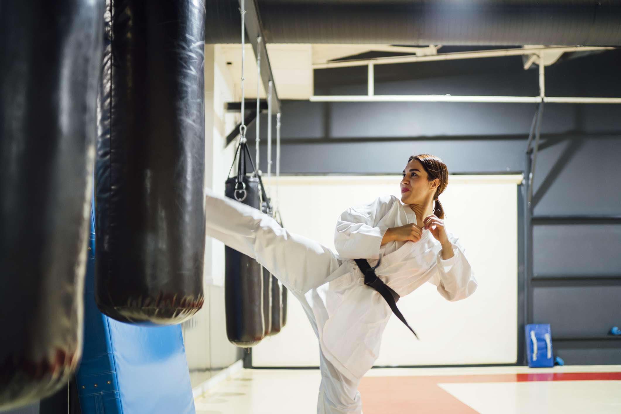 Woman practices karate