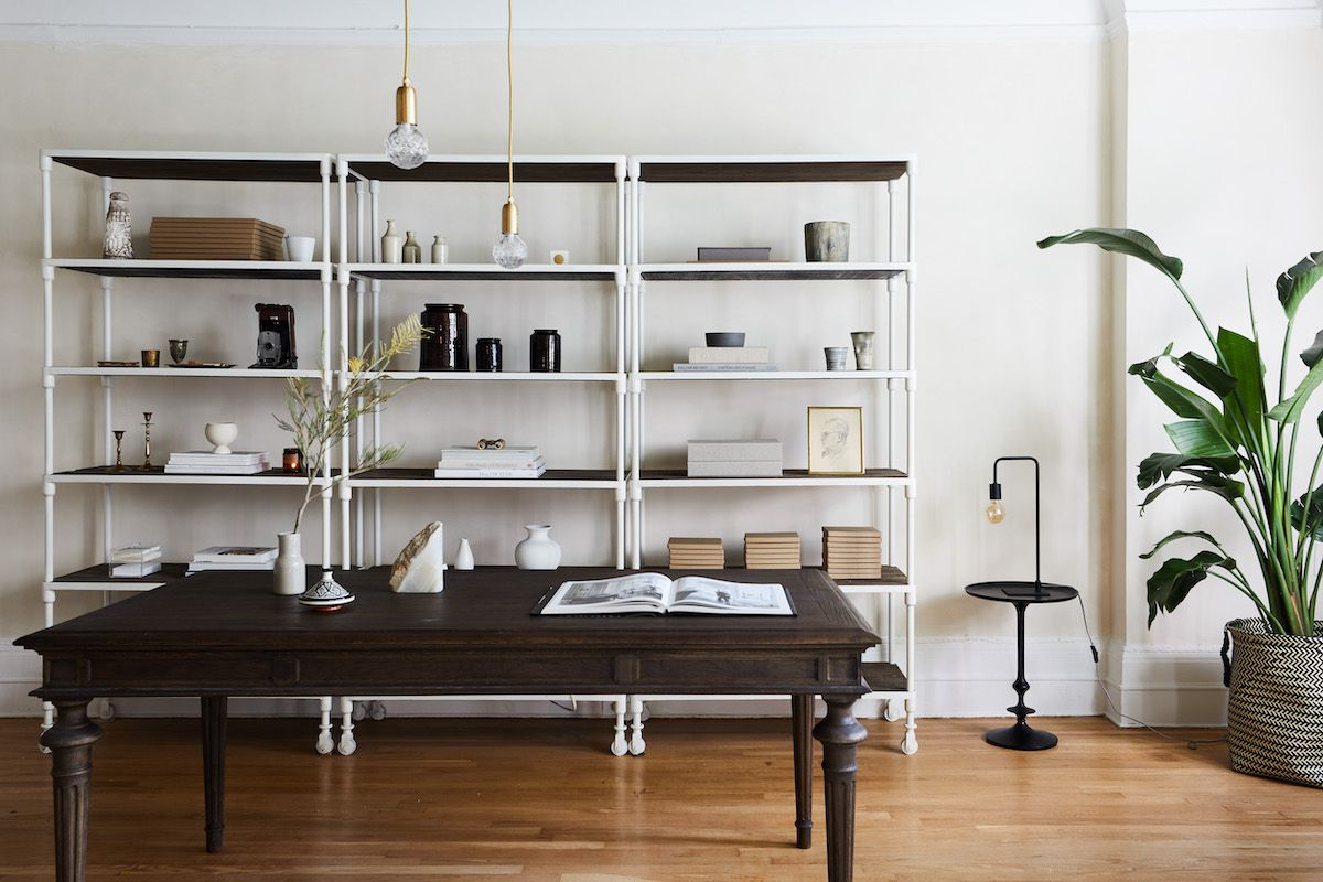 A home office filled with a combination of modern and antique furniture