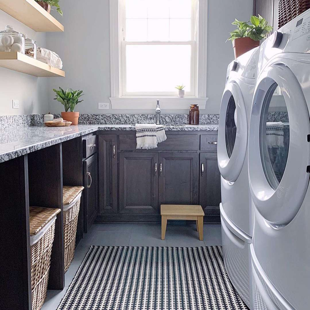 Laundry room with unfinished wood shelves