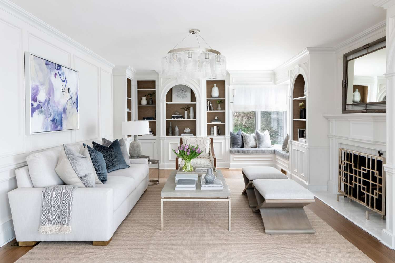 White living room with built in shelving.