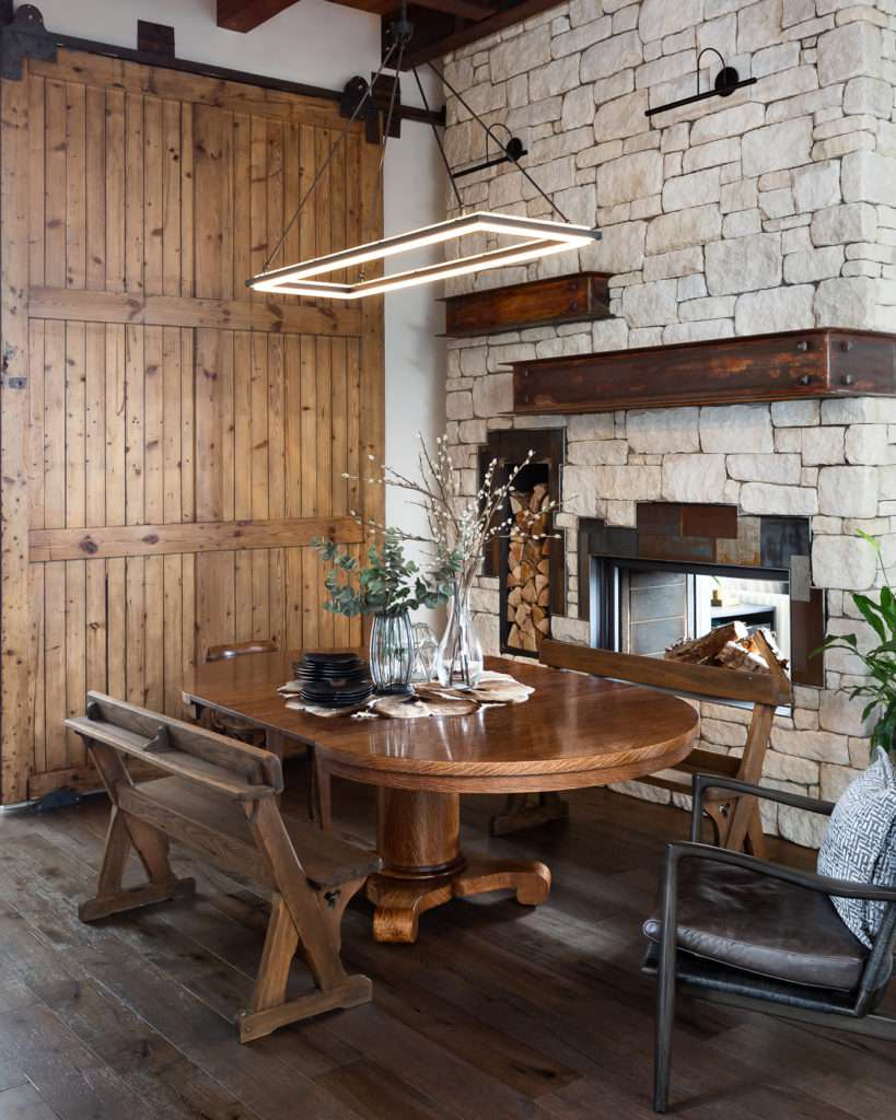 Modern rustic dining area with sliding barn door