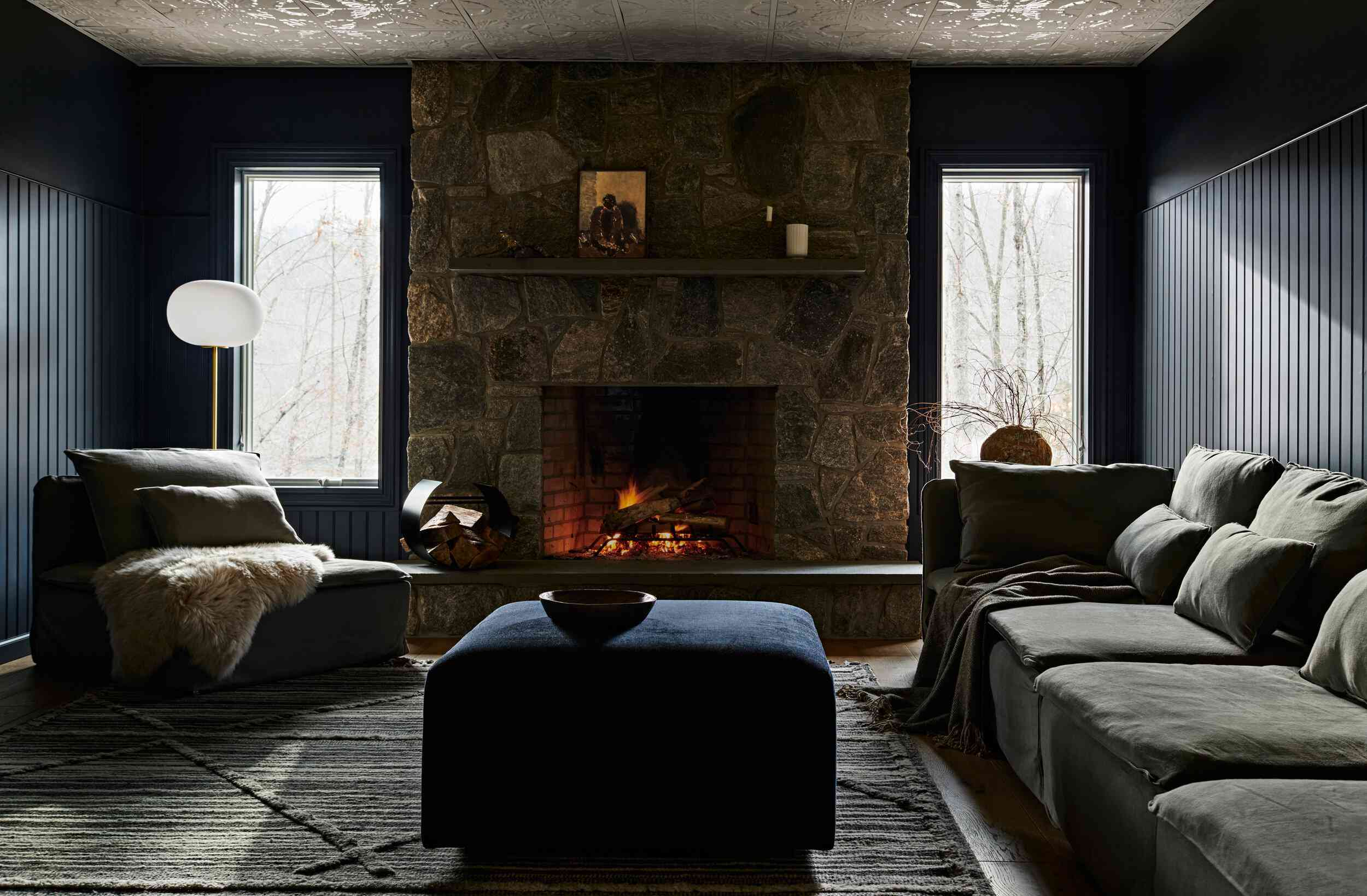 Rustic and cozy living room with natural stone fireplace