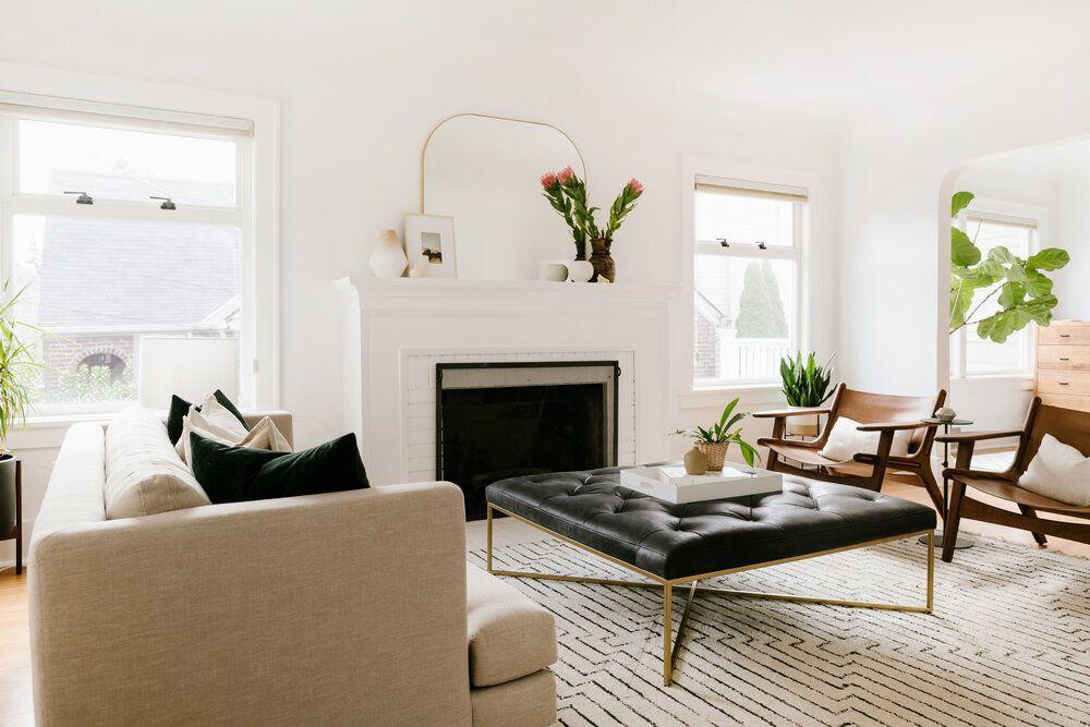 Living room with black ottoman
