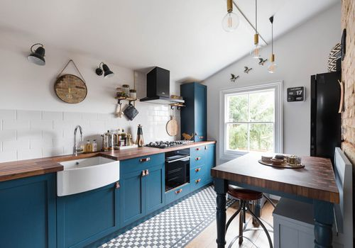 Blue kitchen with wood countertops