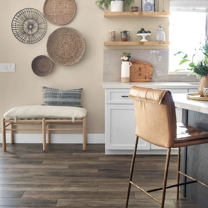 kitchen with wooden floor, bench with cushion, wicker basket decor on wall