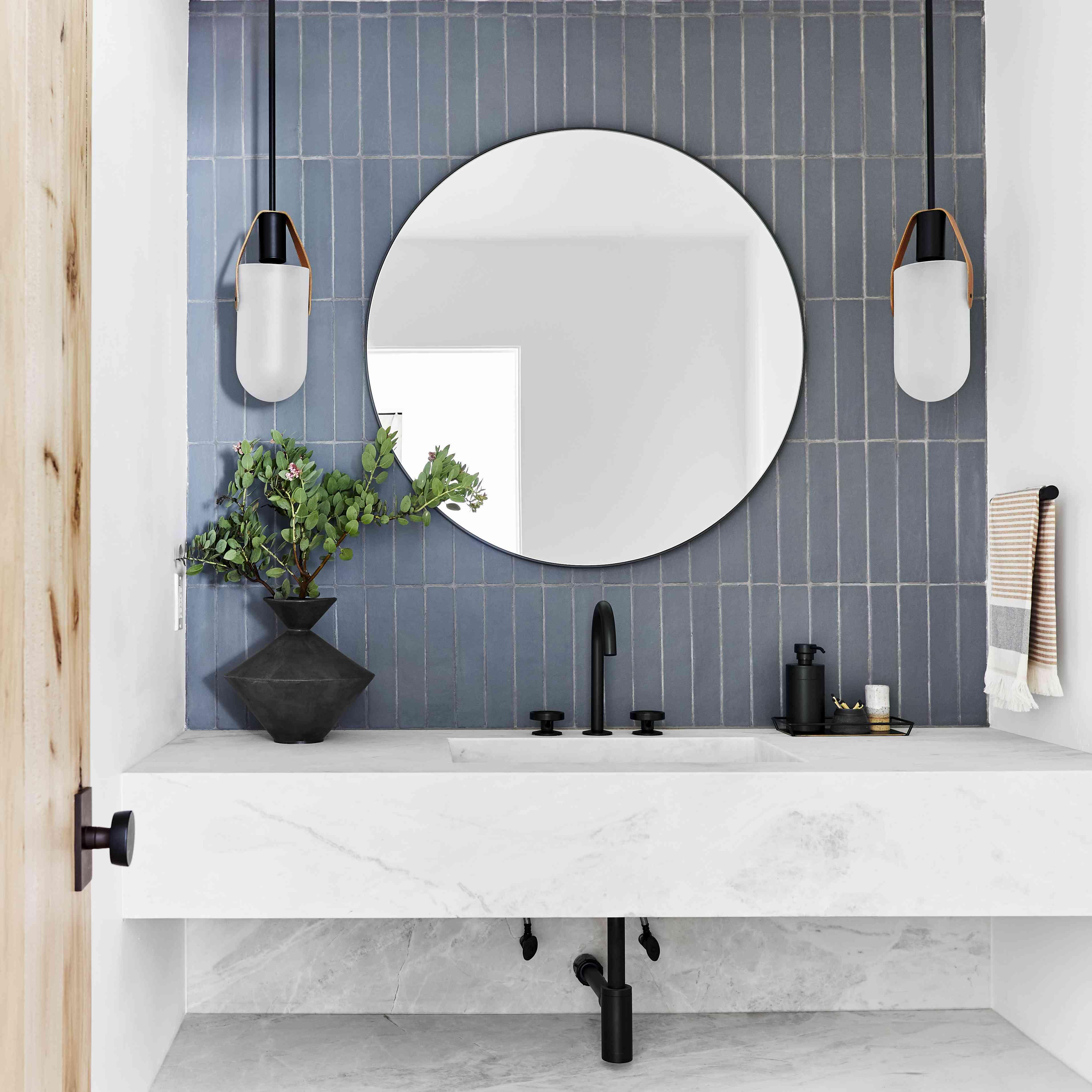 how to clean a mirror - clean round mirror in bright bathroom
