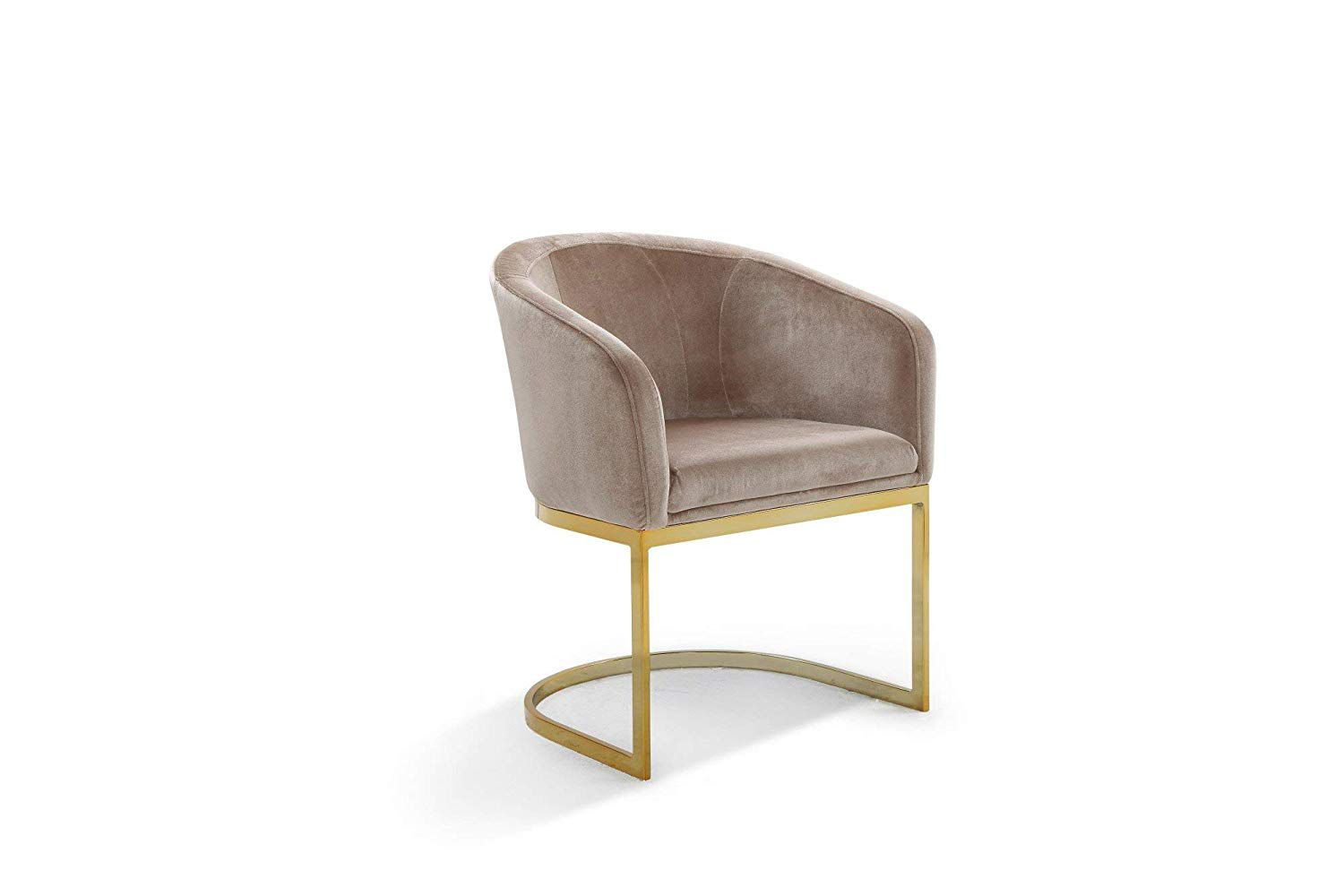 A taupe velvet chair with a gold, half-moon base.